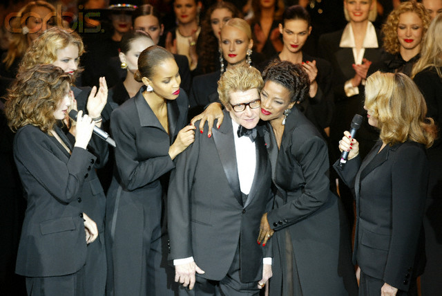 22 Jan 2002, Paris, France --- Fashion designer Yves Saint Laurent on the runway after his spring 2002 haute couture show at the Pompidou Centre in Paris. The collection and retrospective show marked the retirement of Saint Laurent. --- Image by © Fairchild Photo Service/Condé Nast/Corbis